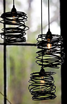 SPIRAL NEST, decided to go with this type wire shade to help with hiding the ugly energy saving bulbs. Wiring them as indivual lamps with a hidden power strip so they be moved around easily.