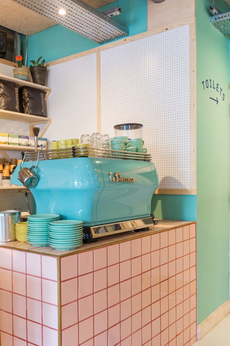 pastel green coffee machine, pink tiles, pegboard, 400 rabbits pizza restaurant