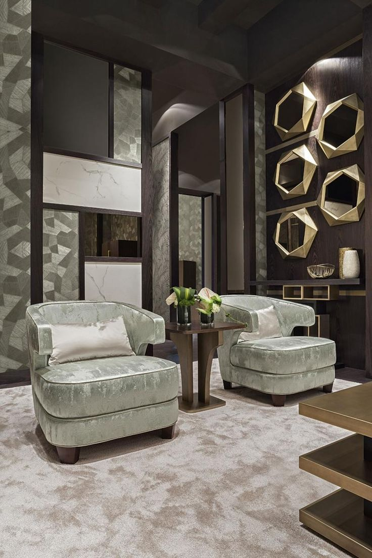The Jade Lagoon room by Oasis, featuring two Joelle armchairs.