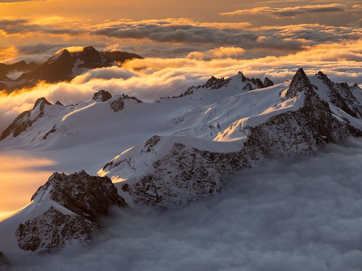 Aerial picture of Southern Alps peaks above clouds, New Zealand