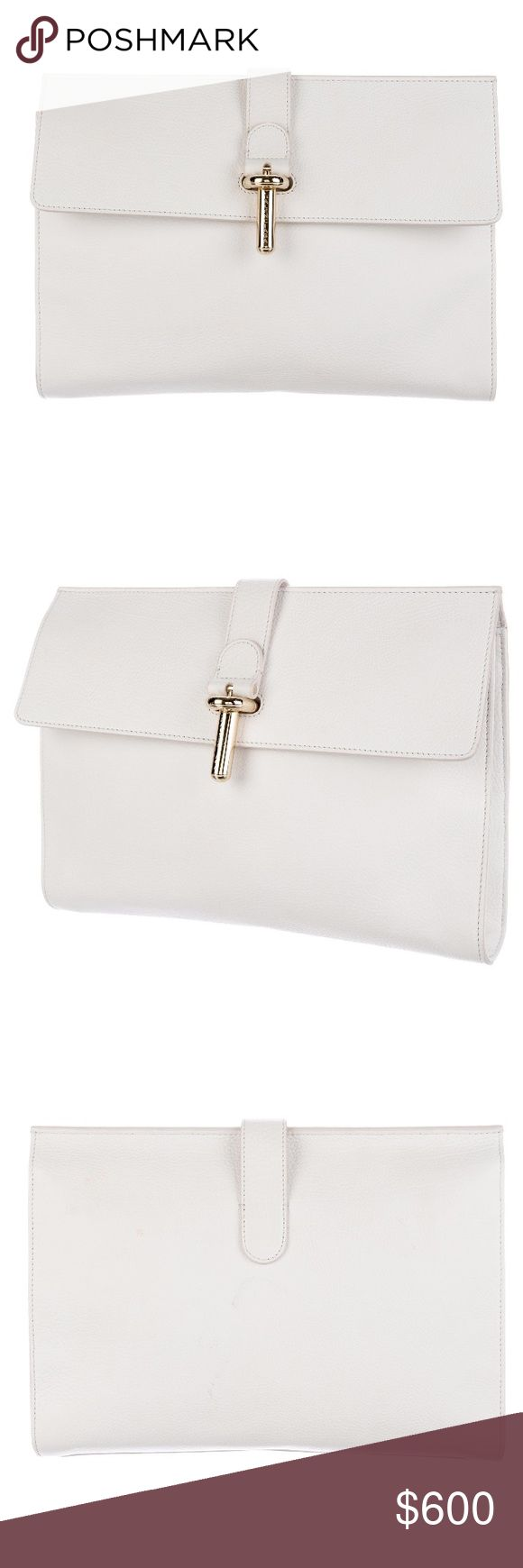 """💕BALENCIAGA CLUTCH AMAZING BALENCIAGA WHITE CLUTCH!!!  Used but in very good condition (3rd photo shows some discoloration on the back which is hardly noticeable). This is from the Spring/Summer 2014 collection.  It is white grained calfskin leather with gold tone hardware.  Inside it has wall pockets as well as a zip pocket.  Height- 9"""", Width- 11.5""""  This is 100% Authentic which Poshmark will authenticate when this is purchased. Thanks for checking this beautiful clutch out! :) Balenciaga…"""