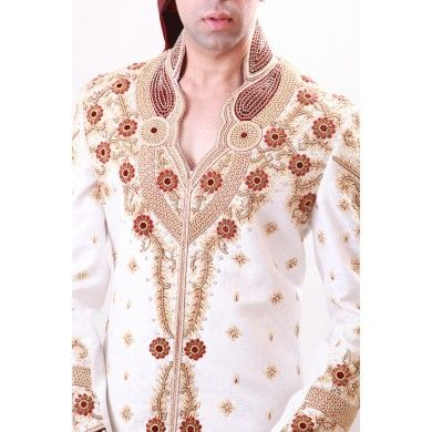 Heavily crafted magnificent king-wear #Sherwani. Heavily crafted with every kind of beyond compare work, this magnificent king-wear throws a compelling charm in the air for your noticeable event of life in its own charming way. Buy online at www.ethnickurtas.com