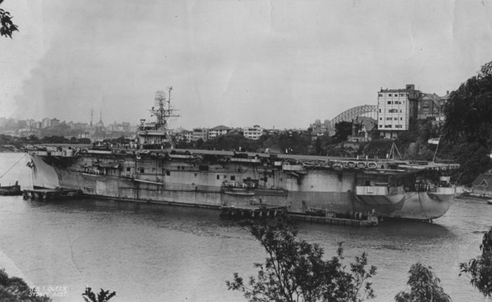 HMS Queen seen at Sydney Harbour in January of 1946. Following the war in Europe, Queen was deployed to Australia on a single return voyage as a troopship carrying New Zealanders home to the antipodes as well as some sailors from the Royal Australian Navy.