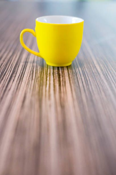 yellow coffee cup in coffee shop