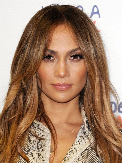 """CARAMEL BROWN  """"This is a lot of color,"""" says Robinson. But these golden highlights still flatter—and illuminate—Jennifer Lopez's complexion because her base is brown. The lightest sections are toward the mid-length and the ends. To get Lopez's color, ask for a light brown base, and add highlights around the face out to the ends, gradually getting lighter toward the tips of the layers."""