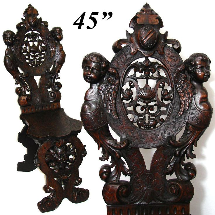 Antique Italian Renaissance Carved Walnut Hall Chair, Winged Cherubs, from antiques-uncommon-treasure on Ruby Lane