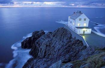 Kråkenes Lighthouse in Vågsøy, Nordfjord, Fjord Norway. Copyright © Thomas Bickhardt/BickFoto