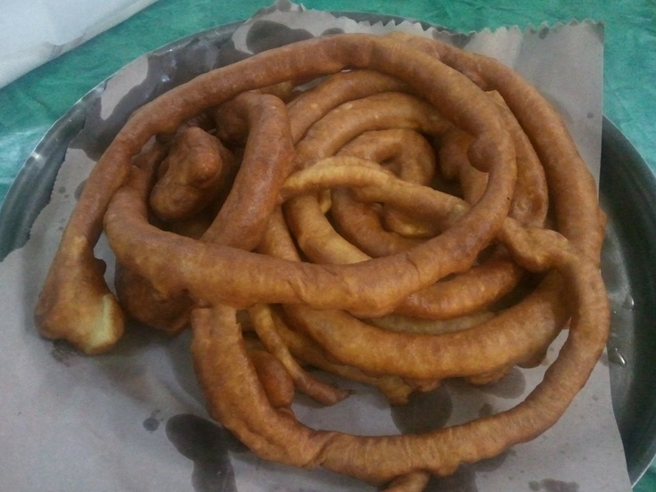 """Traditional long fritter from Sardinia. We have them at Carnival. The original name is """"Frisgioli longhi"""". You can eat them like this or with sugar or honey. Yummy!"""