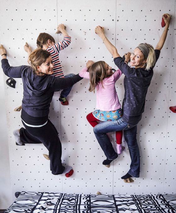 An indoor climbing wall transforms the living room into a playground