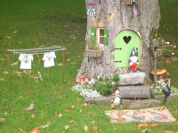 Gnome Garden Ideas find this pin and more on gnome village ideas for back yard Tree Stump Gnome House Gnome House In Other Town