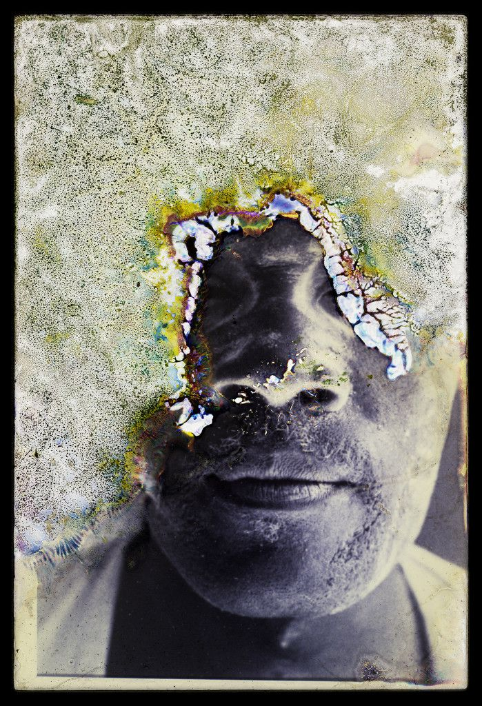 Picture of a water-damaged portrait of a dock worker in Louisiana