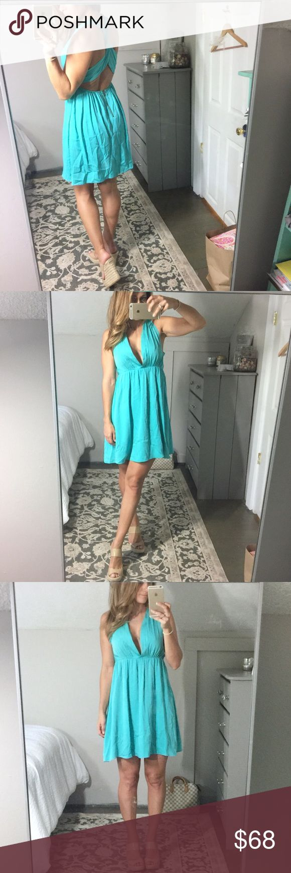 Alice + Olivia cross cross back turquoise dress S Alice + Olivia cross cross back dress - so fun and sexy - please excuse the wrinkles as I just moved.  Just needs to be steamed or pressed.  Worn about 3x - excellent condition - automatic 20% discount on bundles of 3+ items 🛍 Alice + Olivia Dresses Mini