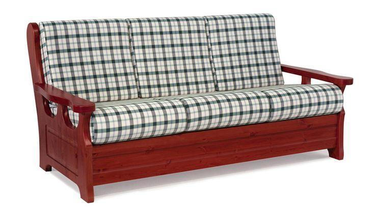 Divano rustico in legno massello di pino di Svezia, proposto in finitura rosso marrone. www.arredamentirustici.it
