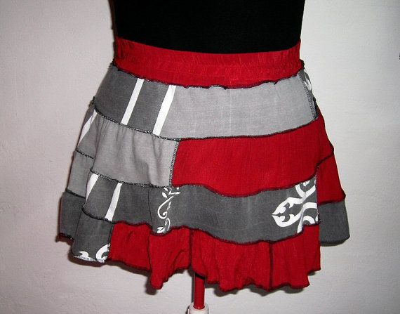 My signature outfit for my character design is this red and gray upcycled skirt (made by khaoskouture on etsy) with a gray shirt. Upcycled seat belt with bottle caps. 4 bird divergent necklace.