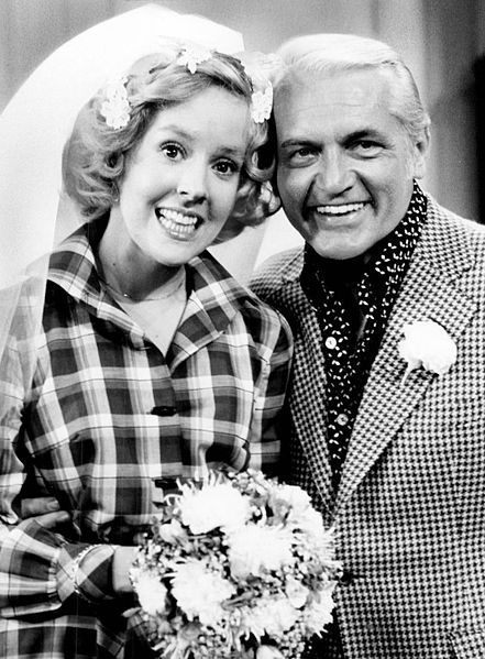 Ha! I'm watching this episode right now with my grandmother :) She's cracking up. Photo of Georgia Engel and Ted Knight from the television program The Mary Tyler Moore Show. Georgette Franklin (Engel) and anchorman Ted Baxter (Knight) have just been married at an impromptu ceremony at Mary Richard's (Tyler Moore) apartment. 1975