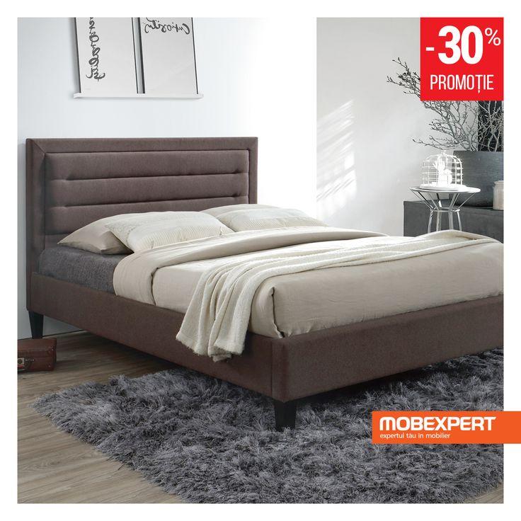 Stofa de culoare bruna in care este tapitat si modelul decorativ discret al tabliei recomanda patul Lloyd drept o alegere inspirata pentru a crea un decor elegant in dormitor. Somiera inclusa ofera sustinere adecvata pentru saltea, astfel incat sa va puteti bucura de un somn odihnitor de fiecare data. #mobexpert #pat #dormitor