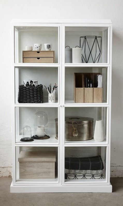 //a substantial freestanding unit like this lends some architectural style detailing to a plain space... Keeping the colour palette simple & the shelves well styled will make a room feel finished//
