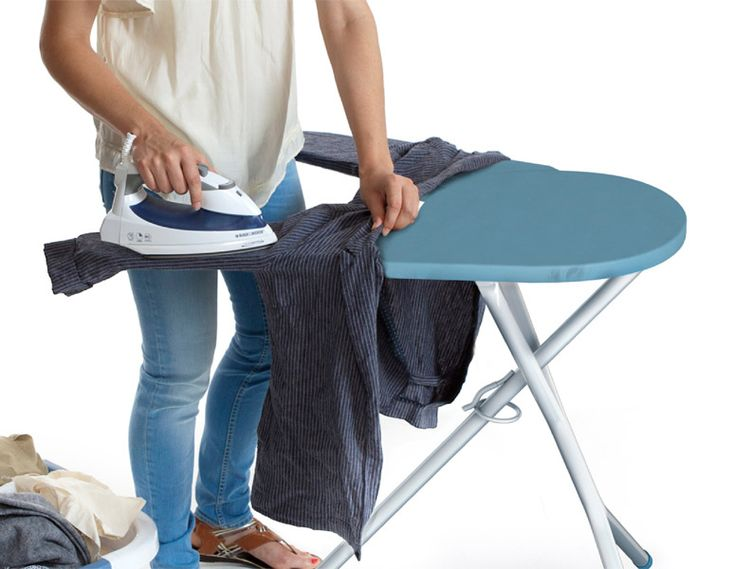 This modern ironing board re-imagining pivots open allowing you to slide sleeves and pant legs onto smaller, individual arms for easier ironing, clamps shut to hold shirt cuffs and collars, and rotates closed for traditional use.