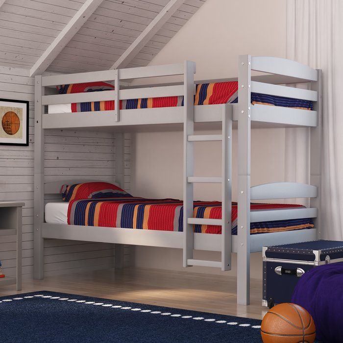 Need more room for activities? Give your little ones a playful retreat with this beautiful bunk bed! Constructed of solid pine wood, it takes on a clean-lined silhouette with gently curved head and foot boards for a little added elegance. While slatted panels lend a touch of distinction, a solid finish allows this piece to blend beautifully into any setting. Keep it simple with crisp white quilts and a striped rug on the floor below, perfect for defining the now spared space in the center of…