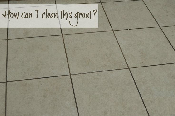 When we moved into our house, I really liked the floor in our main bathroom. It had small blue tiles and white grout, and it's in an interesting geometric pattern. #Clean_Grout_Naturally #cleaners