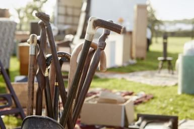 walking sticks for sale at highway yard sale - Mint Images/Mint Images RF/Getty Images