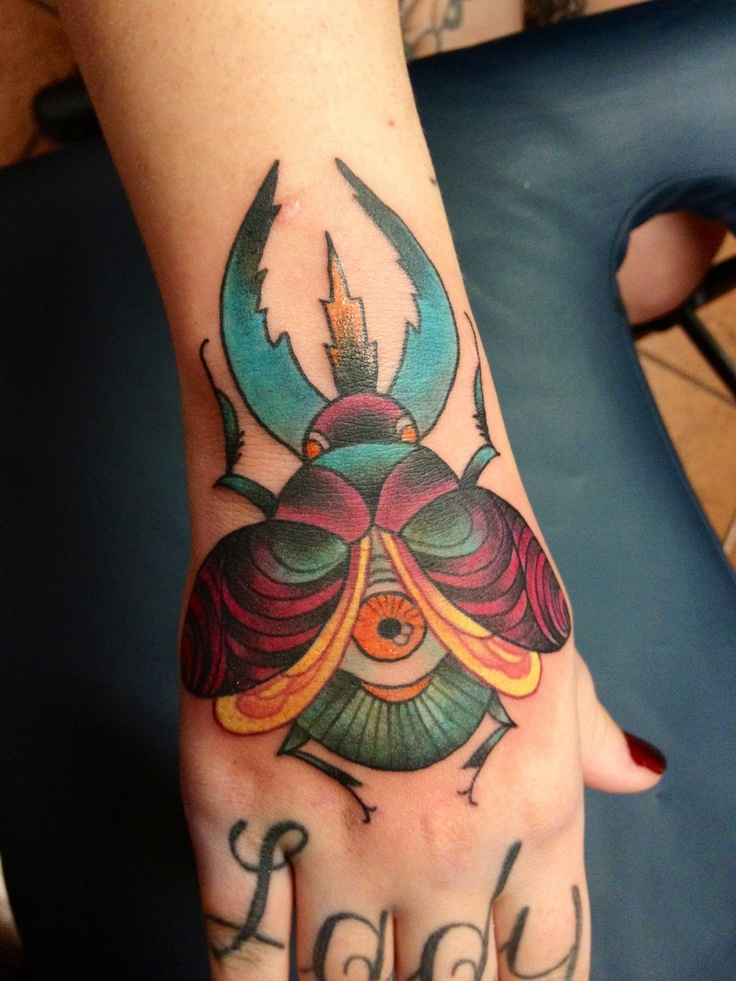 One Piece Hand Tattoo: Beetle Hand Piece By Madame Tattoo Instagram