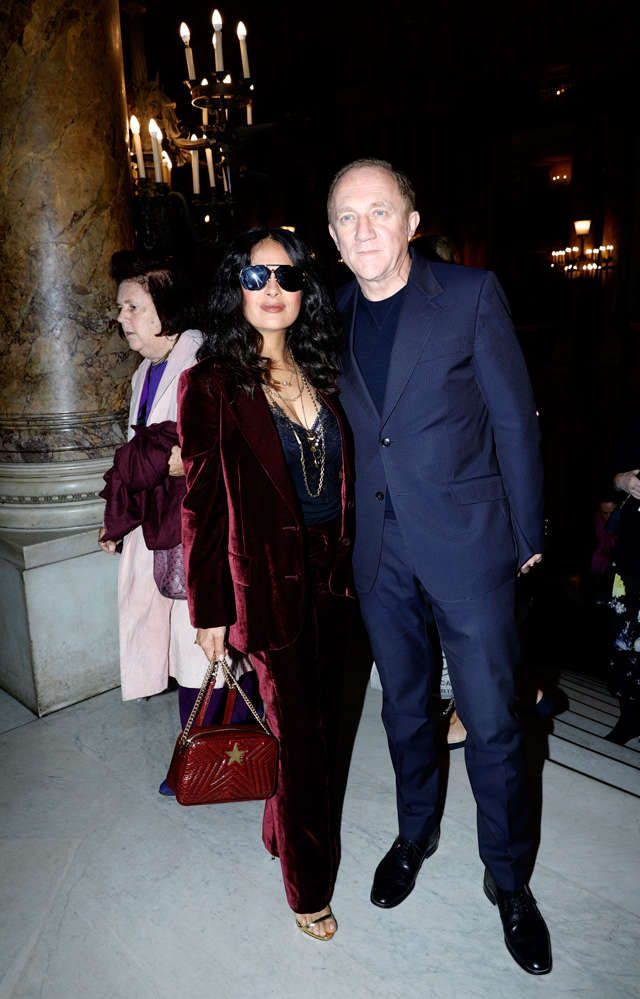 Kering CEO Francois-Henri Pinault poses with his wife actress Salma Hayek before Stella McCartney's Spring-Summer 2018 ready to wear fashion collection in Paris.  Salma Hayek, 51, and her billionaire husband Francois-Henri Pinault, 55.  Natalia Vodianova, left, singer Kylie Minogue, and...