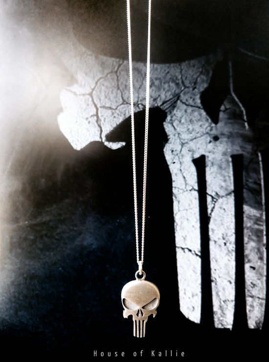 The Punisher Pendant in Sterling silver on a sterling silver chain (45cm)   each pendant comes packaged in its own hand made solid wood gift box, prices include door to door delivery for those of your residing in South Africa.