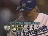 Kirk Gibson - October 15, 1988 World Series, Game One, Bottom of 9th Inning, 2 Outs, with a runner on first, 4-3 Oakland winning. Both legs are injured and he has not been able to play the entire game.  He comes in as a surprise pinch hitter to bat.  He limps up to the plate.  Gets to a full count, 3 balls and 2 strikes. The next pitch made history as Gibson jacks a home run to right field to win the game and hobbled around the bases.  Click pick to see the famous last inning.