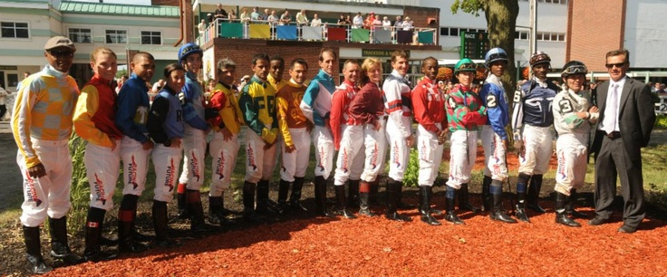 Canadian Jockeys join the cause for fairness!    The jockeys from left to right are as follows: Patrick Husbands, Emma-Jayne Wilson, Jermaine Bridgmohan, Melanie Pinto, Brian Cheyne, Daniel David, Roderick Dacosta, Eldridge Lindsay, Corey Nakatani, Steve Bahen, Todd Kabel, Regina Sealock, Slade Callaghan, Howard Newell, Omar Moreno, Terry Husbands, Kirk Johnson, Real Simard and Robert King- Executive Director- Jockeys' Benefit Association of Canada