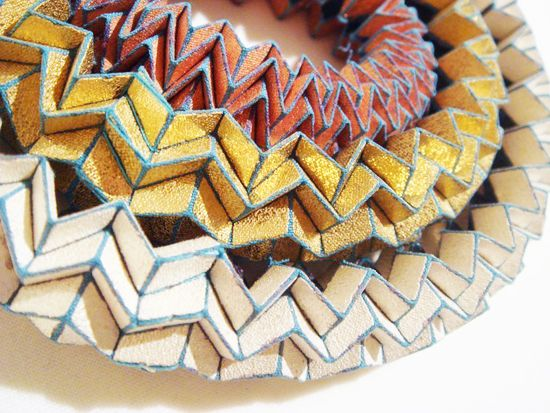 TINE DE RUYSSER-BE makes amazing folded textile accessories like these three bracelets (copper, gold plate, silver and polyester)