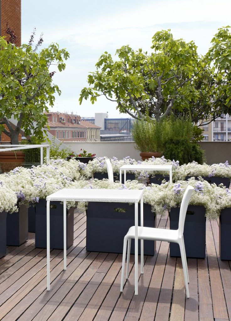 The Grillage outdoor bistro table, stocked in Black and White. 73h x 70 x 70 cm