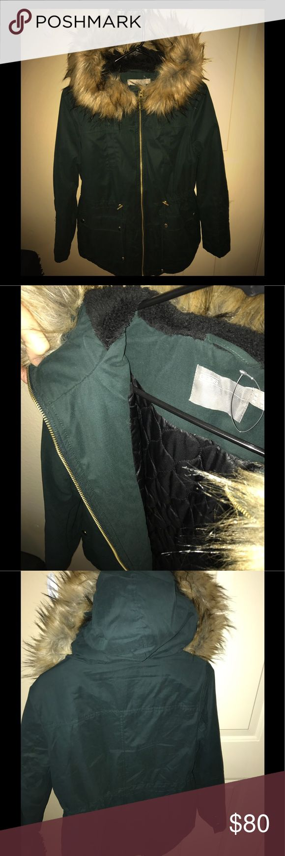 Winter coat/Jacket Warm green winter jacket with faux fur hood and gold zipper. I have worn it once, practically has the tags on. Super cute for the winter snow! Asos Jackets & Coats