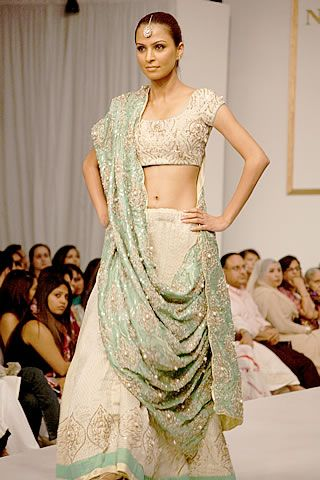 sea green and white lengha with gold embellishments