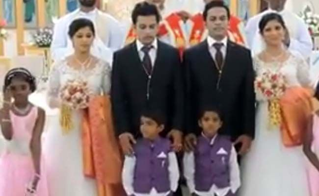 Twin Brides. Twin Grooms. Twin Priests. This Wedding is Twice as Nice