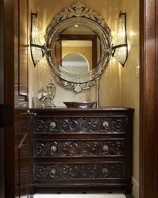 Beautiful mirror & sconce - they make the room. Love the ornate dresser, but the sink looks a little small - even for a powder room. (Via @Houzz)
