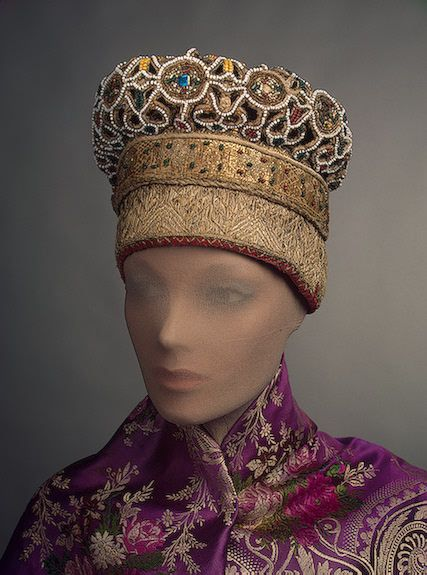 Maiden's Headdress, Vologda Province  Russia, circa Second half of 19th century.  Made of linen, galloon, cord, foil, glass beads, twist, satin, red calico and printed cloth; embroidery. 36 x 15 cm.