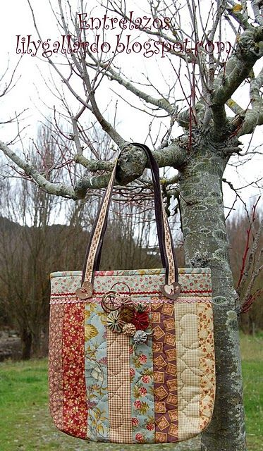Patchwork bag with horizonal band at top, vertical bands for body, charming use of rusts, aquas, browns