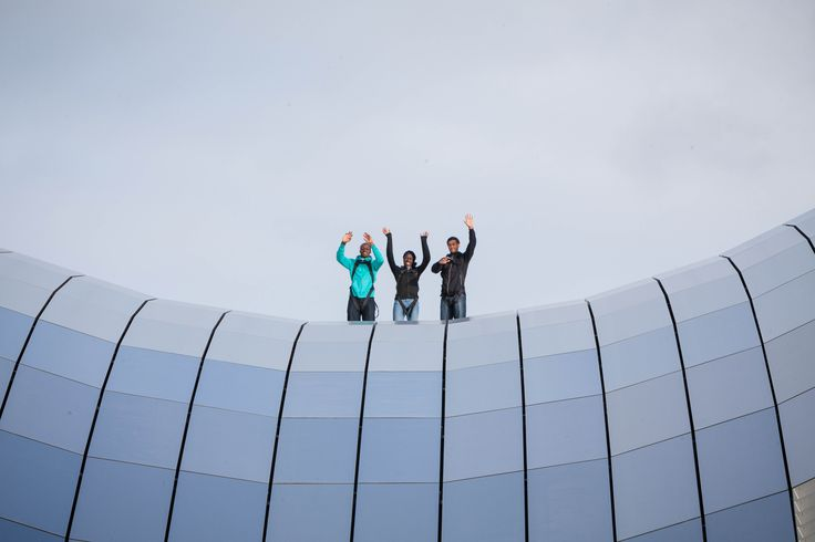 Braver than a lot of us! Up high - top athletes Ryan Wilson, Christine Ohuruogu and James Dasaolu wave from the very top of Sage Gateshead.
