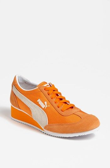 I am amussed that the sneaker called 'Caroline' has a wedge heel. That's right. If I am forced to wear a tennis shoe, that baby is going to have a heel. PUMA 'Caroline' Wedge Sneaker (Women) | Nordstrom