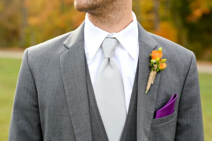 Gray suit, silver tie, orange (would be cream for mine) spray rose ...