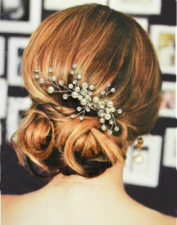 This exquisite Paris bridal hair comb is made with beautiful white acrylic pearls, crystals and clear beads. All arranged in an intricate sweeping leaf design and wired by hand to a petite comb that measures .25 inches wide. This wedding comb provides the perfect finishing touch whether you are wearing your hair in an up-do or long and flowing! The decorative part of the comb measures approximately 5 inches long and 3 inches wide. Since each comb is handmade there may be slight variations in…