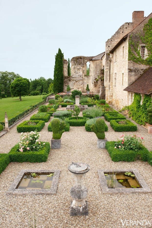 Ruins of a French Monastery: Plantings in the Medieval garden include roses, lavender, and topiary via Veranda