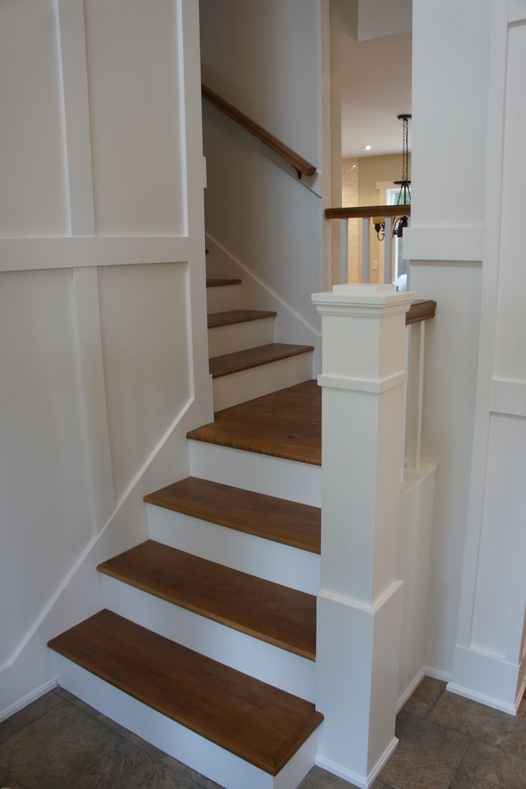 wood stairs with painted risers