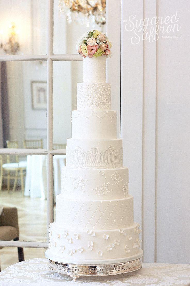 All White 7 tier wedding cake by Sugared Saffron Cake Studio in London