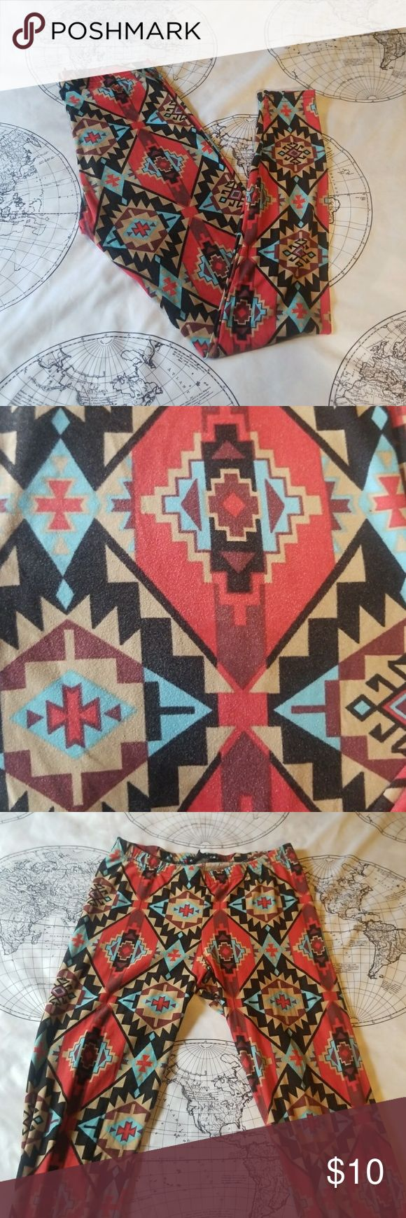 """Aztec Leggings Tribal aztec leggings. Feel amazing. eyecandy brand. Festival. Rave. Casual. Lounge. Bundle for savings. Says size small-petite, but i think fits small. Inseam 28"""". Colors red, black, blue, cream eye candy Pants Leggings"""
