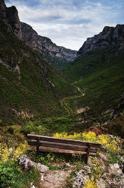 Hiking the Vikos Gorge in the Vikos - Aoos National Park, Epirus Greece. The Víkos Gorge cuts right through the limestone uplands of Mount Gamíla for 20km, separating the villages of western and central Zagori. With walls almost 1000m high in places, a hike through or around it is probably the highlight of a visit to the Zagori.