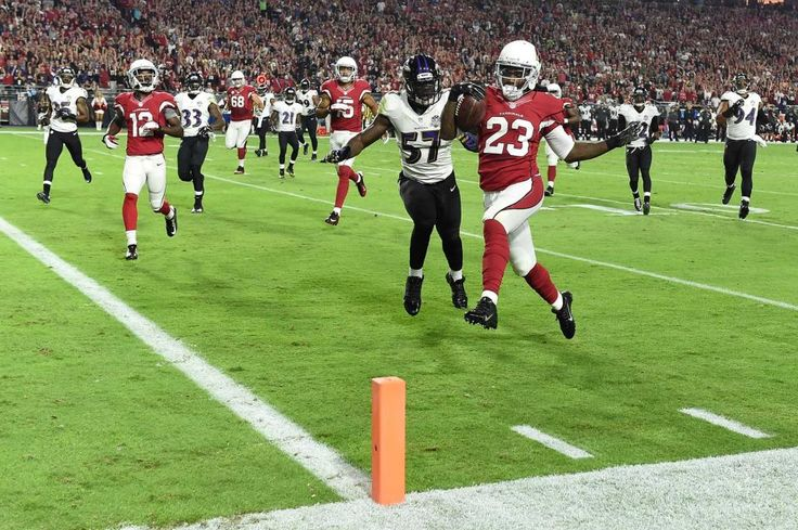 GLENDALE, AZ - OCTOBER 26: Running back Chris Johnson #23 of the Arizona Cardinals runs in a 26 yard touchdown against linebacker C.J. Mosley #57 of the Baltimore Ravens in the first quarter of the NFL game at University of Phoenix Stadium on October 26, 2015 in Glendale, Arizona. (Photo by Norm Hall/Getty Images)