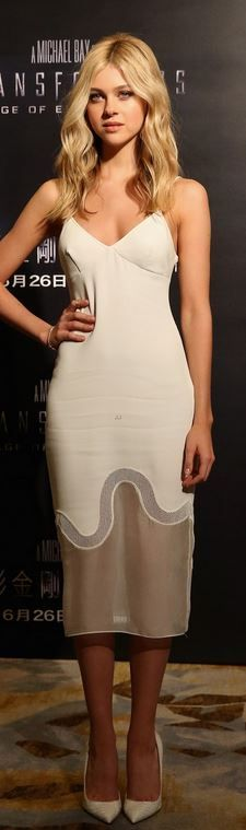 Who made Nicola Peltz's nude dress that she wore in Hong Kong on June 20, 2014? Stella McCarntey