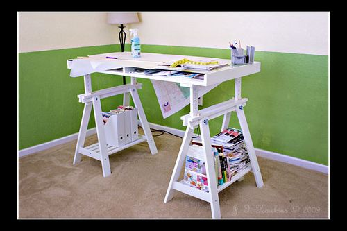 Cool Ikea worktable with adjustable top and table-top storage